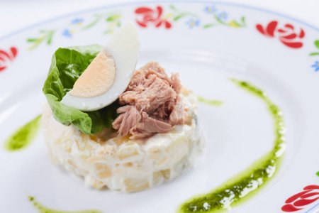 salad with tuna on white plate, close-up