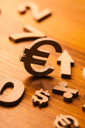 Set of numbers and currency symbols  on wooden table