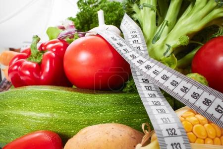 Photo for Fresh vegetables with measuring tape, close-up - Royalty Free Image