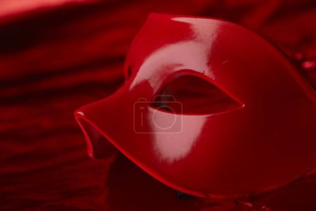 carnival red mask for holiday on dark background