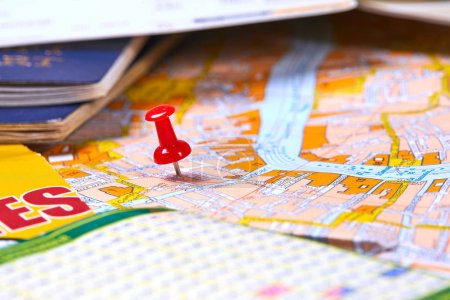 pin marking travel itinerary points on map with passports