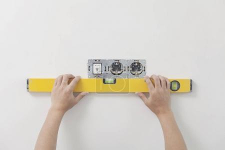 Photo for Use of the measuring tool for level installation - Royalty Free Image