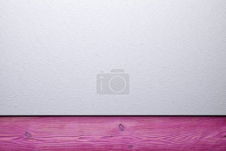 Two layer background - plastered surface and pink wooden plank