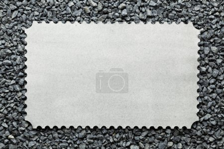 Blank paper sheet on gravel background