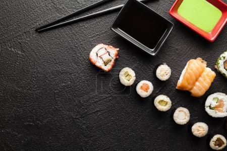 Japanese sushi rolls on black table