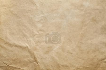 Crumpled handmade paper sheet - background or texture