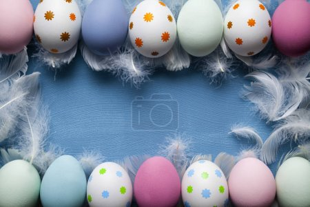Easter background - White and colored eggs on blue background