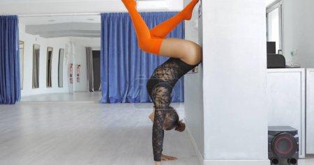 Young dancer doing handstand