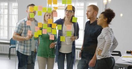 Colleagues working together in modern office