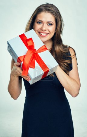 Smiling woman with long hair holding gift box.
