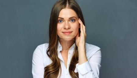Face close up portrait of confident business woman.