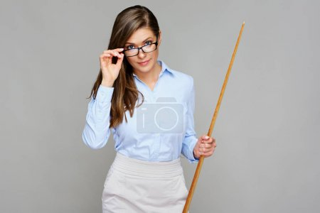 Woman classic smiling teacher holding wooden pointer.