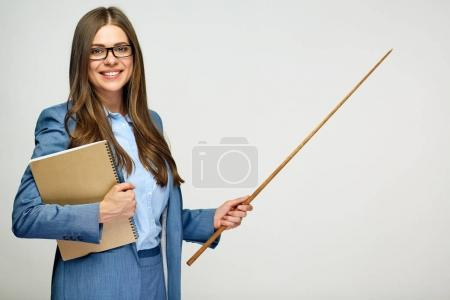 Portrait of young teacher holding pointer with books.