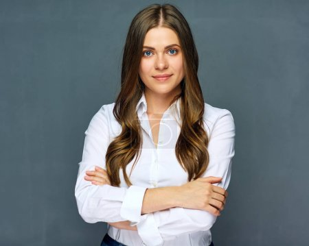 portrait of businesswoman in white shirt with crossed arms