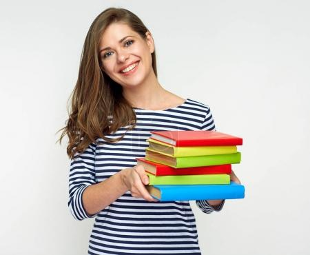 smiling student woman holding pile of books, education concept