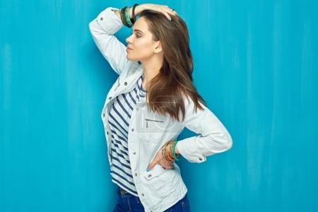 beautiful woman posing on blue wall background