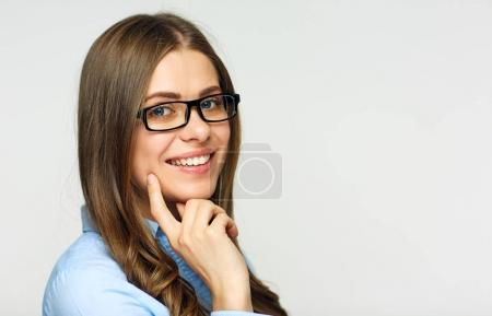 smiling businesswoman wearing glasses looking at camera