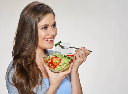 Woman eating salad. Isolated portrait