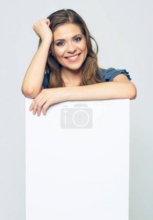 Photo for Smiling woman holding blank business sign board - Royalty Free Image