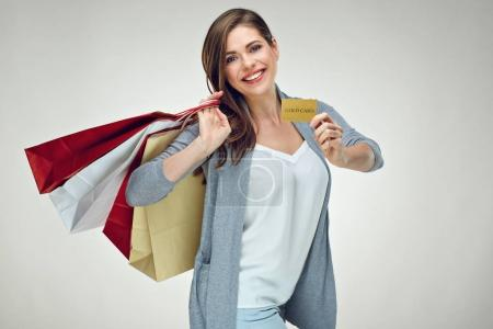 casual dressed happy woman holding shopping bags and credit card for successful shopping
