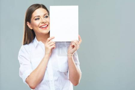 Photo for Business woman hide face behind white sign board. Positive emotional female model. Isolated portrait. - Royalty Free Image
