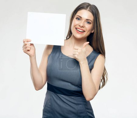 Photo for Smiling woman holding blank sign board and showing thumb up - Royalty Free Image
