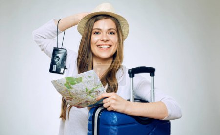 happy woman traveler holding paper map with camera and suitcase