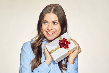 Photo for Smiling businesswoman holding gift box with red bow - Royalty Free Image