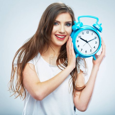 Photo for Young smiling woman hold blue watch. Beautiful smiling girl portrait. Isolated studio background female model. - Royalty Free Image