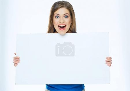 Photo for Surprised woman holding advertising board. Big white banner with copy space. - Royalty Free Image