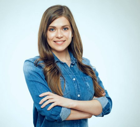 Photo for Portrait of smiling woman wearing blue denim shirt posing on light background - Royalty Free Image