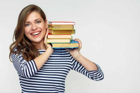 smiling woman wearing striped shirt holding pile of books, examination concept