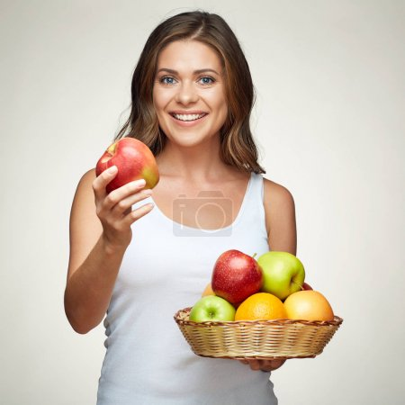 fruit diet for young healthy woman with apples and citrus.