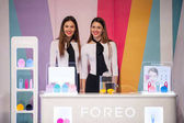 Two hostesses present Foreo LUNA mini facial cleansing brushes