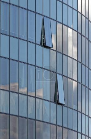 Photo for Skyscraper office building with two open windows. - Royalty Free Image