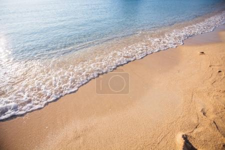 Photo for Wave of the sea on the sand beach - Royalty Free Image