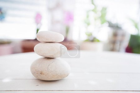 Photo for Zen harmony meditation,stacked of stone, spa lifestyle, on white wooden background at home - Royalty Free Image