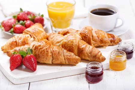 Photo for Breakfast with croissants, coffee, juice and fresh fruits on wooden table - Royalty Free Image