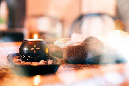 Photo pour Zen basalt stones and spa candle in hotel spa center - image libre de droit