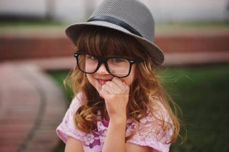 Photo for Photo of little hipster girl with big glasses - Royalty Free Image