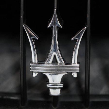 Maserati metallic logo closeup on