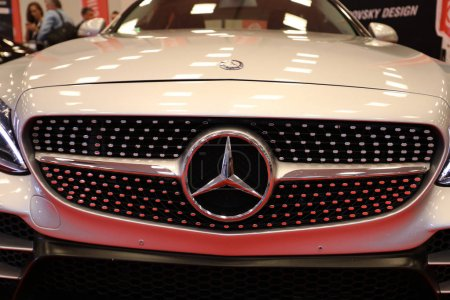 Mercedes metallic logo closeup on Mercedes   car displayed at MOTO SHOW in Cracow Poland
