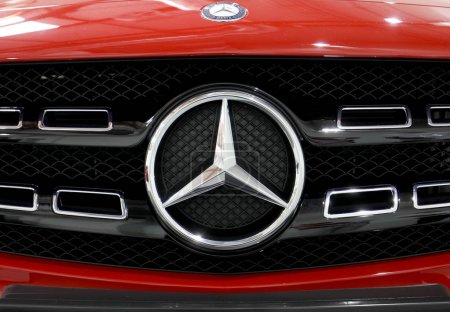 Mercedes metallic logo closeup on Mercedes   car displayed at MOTO SHOW in Cracow Poland. Exhibitors present  most interesting aspects of the automotive industry