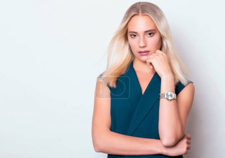Photo for Beautiful young woman with wrist watch - Royalty Free Image