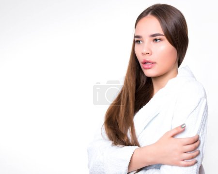 Photo for Beautiful young woman with long hair wearing white bath robe - Royalty Free Image
