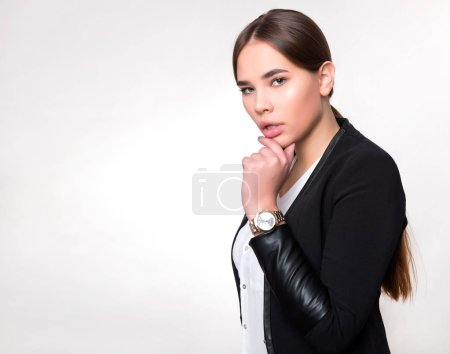 Photo for Beautiful young woman with long hair wearing wrist watch - Royalty Free Image