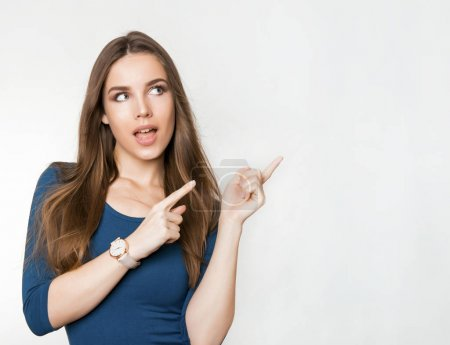 Photo for Beautiful young woman with long brown hair posing on grey background wearing wrist watch - Royalty Free Image
