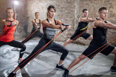 Group of  people doing workout with elastic band