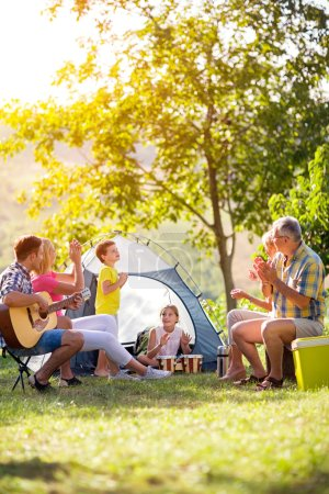 family enjoying on summer day