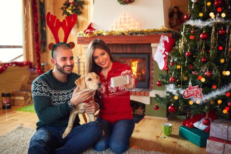Photo of couple with dog at Christmas
